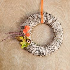 All you need are a few paper bags and a foam round for making this pretty Fall wreath that will look great on your front door. Adorn with a few acorns or an
