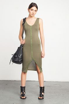 Olive Bodycon Dress - Sleek and clean bodycon dress in the best shade of olive green. The sleeveless tank style dress has faux-button trim design down the front, elongating the body and the front slit adds a fun touch. There is an inner slip that's mini in length and designed to act as a built-in body shaper (so it's super tight) - it holds everything in and really accentuates the figure.