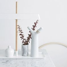 Collection of furniture and home accessories, including a marble tablet stand and oversized cork bottle stoppers.