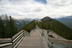 wooden walkways on top of sulphur mountain leading to gondola 1 hour out of Calgary, rent a car and check airbnbs, go in September? Oh The Places You'll Go, Places To Travel, Places To Visit, Banff Canada, Alberta Canada, Banff National Park, National Parks, Sulphur Mountain, Western Canada
