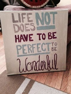 Life does not have to be perfect to be wonderful. Painted canvas. Grey, blue, violet.
