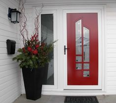 Dressed up Red Glass paneled front door.