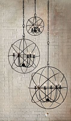 This steel, modern chandelier comes in three different shapes. Great for an entryway or dining room, the Solaris Chandelier will give your room an updated look you'll love.for dinning room Entry Way Lighting Fixtures, Dining Light Fixtures, Entryway Lighting, Dining Room Lighting, Dining Room Chandeliers, House Lighting, Room Lights, Hanging Lights, Entryway Chandelier