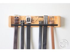 Buckle Up Belt Rack - Add ease to your morning routine with this wall-mounted belt organizer from WoodButcherDesigns! https://www.etsy.com/listing/256180382/buckle-up-belt-rack-a-unique-way-to?ref=shop_home_active_19