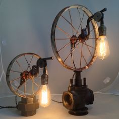 Sold as a set or individually. Vintage bike wheels sit on top of old pipe parts. A single Edison bulb hangs to add light to any room in your space! SOLD