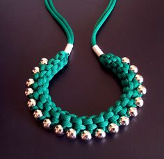 India-inspired necklace ::  Nice tutorial on Instructables, & an entry into their current Handmade Jewelry Contest. Shown with paracord & large metallic-finish acrylic beads. Uses a series of simple cross knots to achieve the woven look.    . . . .   ღTrish W ~ http://www.pinterest.com/trishw/  . . . .   #knotting