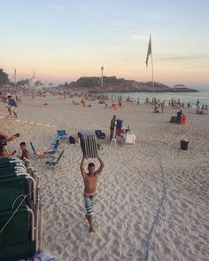 A young man collects beach chairs at the end of the day on Ipanema beach in Rio de Janeiro. by aksensei. traveldeeper #rio #instatravel #instago #instatraveling #ilovetravel #tourist #postcardsfromtheworld #ipenemabeach #wanderlust #ipenema #igtravel #traveling #travelgram #travelblogger #trip #wanderer #travelphoto #worldplaces #traveltheworld #passportready #instapassport #travelpics #travelphotographer #braziltravel #riodejaneiro #micefx [Follow us on Twitter (@MICEFXSolutions) for…