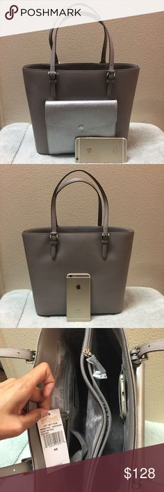 """Brand new Michael Kors big large leather tote Brand new with tag attached. Never used. Never worn. In a perfect condition. Size is 17x11x6. The bottom width is 12"""". The color is pearl gray / silver on the tag. Tag price is $268. The price is firm. Please don't waste your time bargaining. 100% cow leather. Michael Kors Bags Totes"""