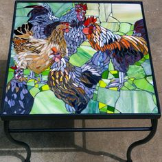 Hen & Rooster glass mosaic on wrought iron table.