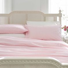 Pink Stripe Bedding 100% long-staple cotton sheets, 1000 thread count.  Feels like silk without the slippy-slidy thing.