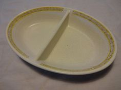 """Very nice vintage Franciscan Hacienda Gold earthenware divided serving dish. The Hacienda pattern began in 1964. It features a southwestern style band of brown triangles on a speckled white background. Measures 11"""" long x 7.25"""" wide x 2"""" tall"""