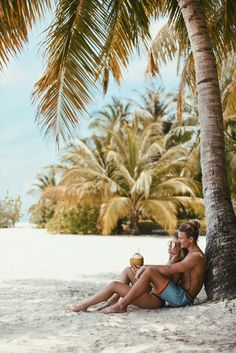 This beach pose, minus the coconuts. Lisa Olsson Maldives