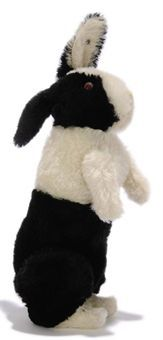 A STEIFF BLACK AND WHITE HOLLAND RABBIT, (5328), jointed, mohair, pink and red glass eyes, pink stitching, swivel head, jointed ears, squeaker and FF button circa 1910 --10½in. (27cm.) high