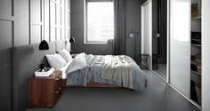 BoConcept floating bed with upholstered headboard, Global nightstands, and Triplo wardrobe