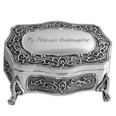 "A beautiful antique silver plated jewellery box with intricate detail and pattern, with four feet and soft navy coloured lining inside. This lovely jewellery box is engraved on the top with the words ""My Precious Goddaughter"". In addition, it can be personalised by engraving of the name - perfect to make your gift extra special and personal. Perfect christening gift from Godmother that everyone will remember!!"