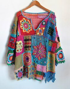Granny square jumper. Mismatched squares joined together, definitely on my list to make.