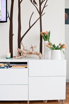 """Sneak Peek: A Crowded Seattle Home. """"The wall decals were found on Etsy. The branch is from West Elm and the furniture piece is IKEA."""" #sneakpeek"""