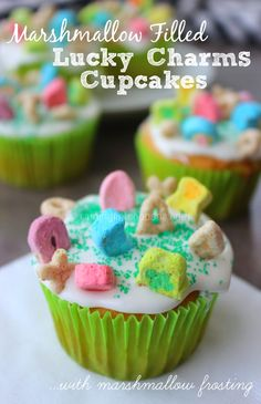 Marshmallow Filled Lucky Charms Cupcakes (with Marshmallow Frosting)