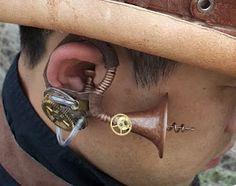 hearing aid, My husband needs an ear trumpet.  Just sayin..