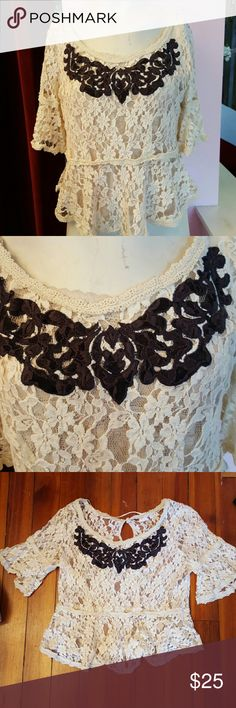 Free People lace top This Free People lace top is white the front of the shirt has a black lace design. The shirt is sheer and looks great over a number of other tops. Perfect for summer looks great with jeans or skirt Free People Tops Tunics
