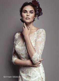 Stunning metallic lace slim A-line wedding dress with romantic illusion three-quarter length sleeves and illusion neckline, Vivyana by Sottero and Midgley.
