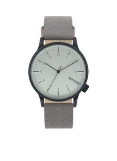 Horloge Winston Concrete van Komono. Dit model heeft een horlogeband van leer, een kast van staal en een witte wijzerplaat. Model: KOM-W2102.