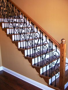 http://www.stairsupplies.com/product-category/wrought-iron-balusters/scroll-series-iron-balusters/