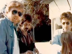 John and Paul were last photographed together in 1974 at the rental home John had on the beach in Santa Monica, Cali during his time he lived with May Pang in Los Angeles. That's Harry Neilsson on the far left