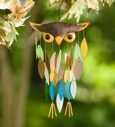 Owl Glass Waterfall Wind Chime | Decorative Garden Accents | Our Owl Glass Waterfall Wind Chime is as beautiful to the eyes as it is to the ears! Gorgeous sand-blown glass feathers in multiple colors dangle down in a triangular pattern from the adorable metal facial features. Small feet hang off the very bottom to complete the owl's body in charming style.