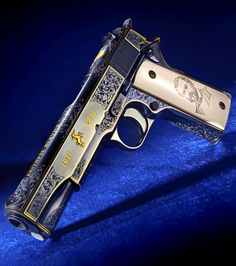 Colt Model 1911 Master Engraved Anniversary Edition features over 300 hours of hand engraving by Colt master engravers in classic American style scroll.