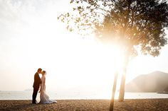 Hong Kong Destination Wedding - Kiss on the beach. Click here to see and learn more about Hong Kong destination weddings: http://blog.mangomuseevents.com/2012/04/13/destination-wedding-location-series-hong-kong/