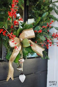 Texas Christmas:  nature elements added to a fake  wreath help spruce up a ho hum doorway.  huntandhost.net