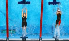 Missy Franklin and China's Jing Zhao dive in at the start of the women's 100m backstroke final
