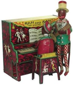 """""""Ham and Sam"""" Minstrel team. Old Tin toy wind up....sold this recently at Antiques Oronoco, MN."""