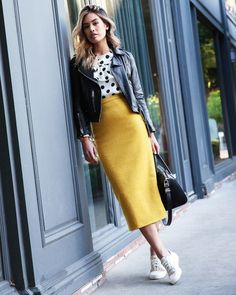 Black leather motorcycle jacket + polka dot blouse + colored pencil skirt + white canvas sneakers
