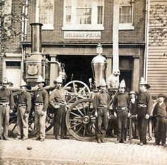 William Penn Hose Company steam engine and fire fighters in front of the company fire station on Frankford Road near Franklin Avenue, Philadelphia. Organized in August 1832, the company is still in operation and is comprised of 100% volunteers.