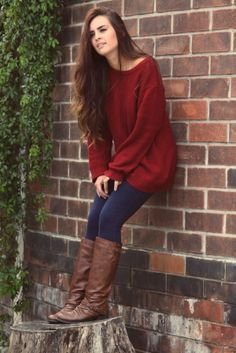 Red sweater with navy leggings and brown boots - a hot combo this fall!
