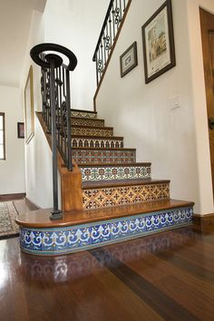 Stair risers are covered w/ colorful Catalina style tiles, which combine glossy & matte finishes. Combine different patterns when selecting patterned tiles, just make sure the colors work well together