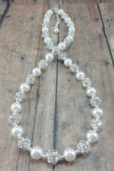gorgeous sparkling wedding necklace // wedding jewelry with pearls and crystals. .Don't forget personalized napkins for all your wedding events!! #itsallinthedetails www.napkinspersonalized.com #weddingjewelry