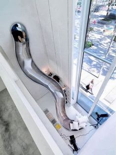 indoor slides are pretty common now, [who the hell is posting this. i dont know anyone with indoor slides.] but I love that this one almost sends you out the window. Fun idea for leading from a childs bedroom, to downstairs playroom, to outdoor play. Indoor Slides, Modern Stairs, Dream Rooms, Dream Bedroom, Cool Rooms, House Rooms, Living Rooms, My Dream Home, Cool Furniture