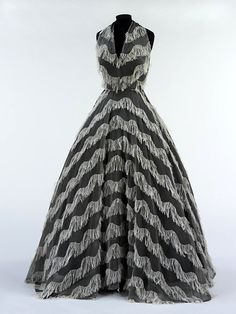 "1951 Evening dress, Jacques Griffe. His tutelage under Vionnet shows strongly in this design. The ""fringe"" is actually a double-weaving technique in which the white threads were interwoven with grey organza. V Museum."