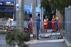 Forensic police are pictured next to a black Mercedes in St Phillip Street in Brunswick East owned by Mr Acquaro, who was shot dead behind Gelobar on Tuesday morning