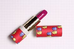LOOK at this lipstick! Elephants on cardboard packaging, brass innertube and a carousel horse on the lipstick itself! I die.