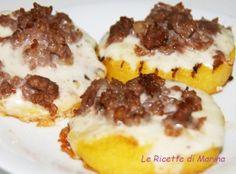 crostoni di polenta con salsiccia e taleggio..