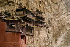 The Hanging Temple Monastery of Hengshan literally hangs on the side of Hengshan Mountain, China sustained by only a few wooden poles.