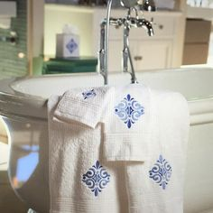 Brighten up your bathroom with these beautiful blue embroidered Almafi Scroll styles. Discover the collection at jacarandaliving.com