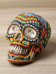 Dia de los Muertos.  This would take a lot of beads and patience but it is so cool