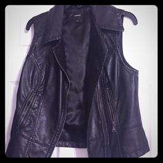 Express leather vest Faux leather vest, but you wouldn't know so. Great quality, perfect for layering. Just the right amount of edge. This vest is a must have! Express Jackets & Coats Vests