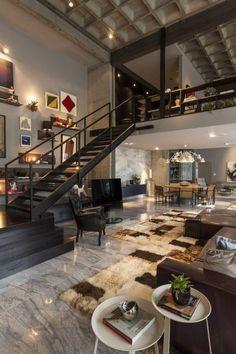 interieur style industriel escalier tournant en bois noir sol en dalles gris