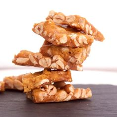 Stacks of microwave peanut brittle for christmas